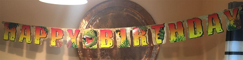 Banner de cumpleaños de Fiestasmix, de temática dinosaurios.